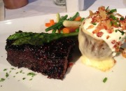 Center Cut Short Ribs served with a raspberry-chipotle glaze, and the baked potato