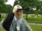 My father - giving his fallen comrades a salute at the Omaha Beach Cemetery in Normandy